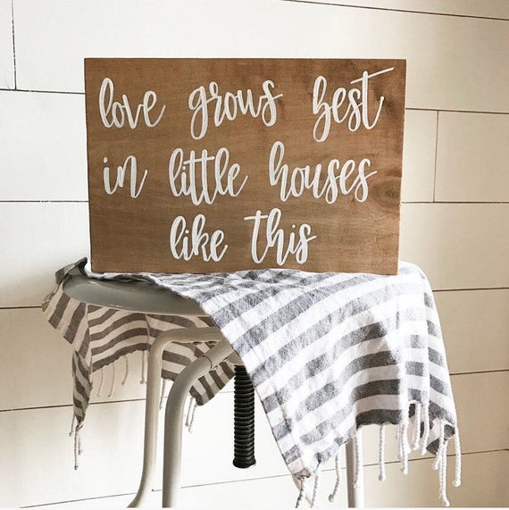 Love grows best in little houses like this - family sign - love - wooden sign