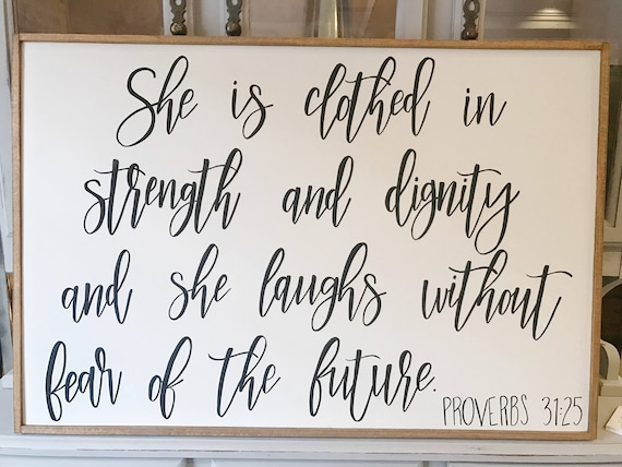 She is clothed in strength and dignity and she laughs without fear of the future - proverbs - proverbs 31:25 - scripture - wood sign