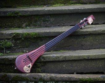 Electric fretless bass ukulele by DaShtick guitars. Solid body ukulele bass.