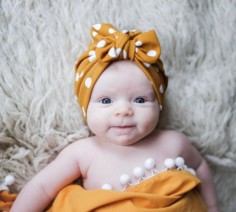 e05b2dc7e8b25 Butterscotch Polka Dot Hat  baby turban hats with top knot