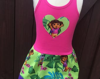 Custom made dress with licensed character fabric. Explorer Cartoon.