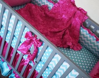 Aqua, pink, baby bedding