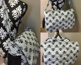 Diaper bag. Messenger style, converts to backpack. Any fabric you want.