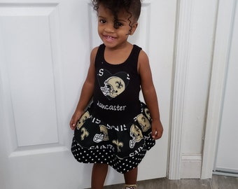 Custom Girls Dress. Made with New Orleans Saints material. All NFL and College Teams Available.