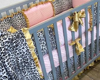 Snow leopard baby bedding. Leopard baby bedding. Leopard crib bedding. Leopard crib set. Baby girl nursery.