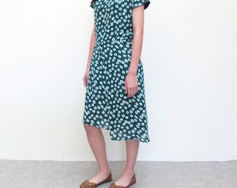 forest green floral dress with flyaway layer piece