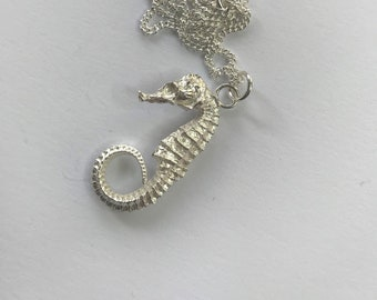 Seahorse pendant, cast in sterling silver with a sterling silver curb chain