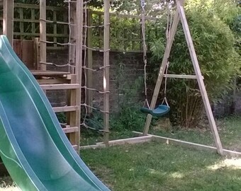Climbing frame with slide, swing, sandpit and other activities