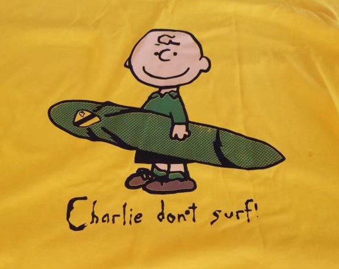 Charlie Don't Surf Tee