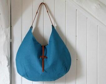 Sac à main style hobo en lin turquoise et coton graphique avec anse en cuir, Grand sac porté épaule, Sac souple en tissu, Cabas en lin