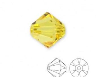 10 bicone 6 mm light topaz Swarovski Crystal bead