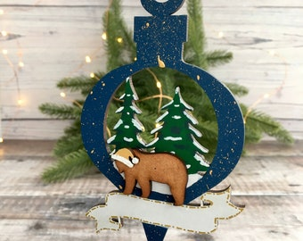 Made to order personalised Christmas bear scene ornament bear in front of Christmas trees with banner