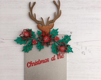 Personalised Christmas at the stag head pennant sign in white golf with holly leaves, flowers and berries.