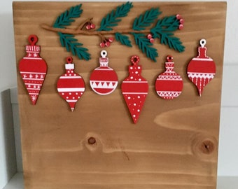 Personalised free-standing Christmas ornaments set under a branch on solid wooden plaque