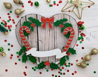 Personalised Christmas Candy Cane wreath with banner on heart shaped plaque with wooden pattern