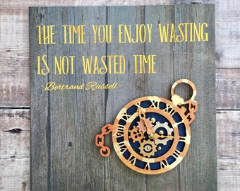 "Steampunk watch sign distressed gold, bronze & copper with quote ""The time you enjoy wasting is not wasted time"""