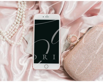 Download Free Glitz and glam silky pink mockup of iphone with rose gold purse and pearls PSD Template