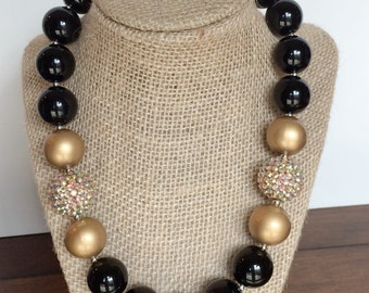 black and gold sparkly bubblegum necklace photography prop
