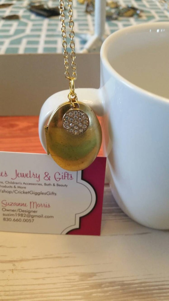 Gold Oval Locket With Charm Accent Necklace