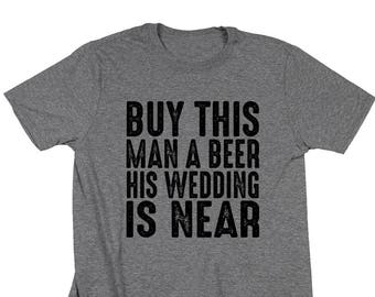 0a38020277 Buy This Man A Beer Shirt. His Wedding Is Near. Groom Shirt. Bachelor Party.  Groom Gift. Funny Wedding Shirt. Getting Married Shirt.