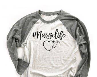 9022e79a4 Hashtag Nurse. Saving Lives. Top Knot Coffee Scrubs Nurse Life. RN. Nurse. Nurse  Gift. Nurse Top. Nurse Shirt.