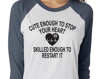 Cute Enough To Stop Your Heart Skilled Enough To Restart It. Nurse Shirt. Nurse Life. Nurses Rock. RN. Nurse. Nurse Gift. Top Knot Nurse.
