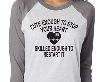 Cute Enough To Stop Your Heart Skilled Enough To Restart It. Nurse Shirt. Nurse Life. Nurse. Nurse Baseball Shirt. RN. Nurse. Nurse Gift.