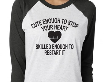 Cute Enough To Stop Your Heart Skilled Enough To Restart It. Nurse Life. Nurse Shirt. Nurse Baseball Shirt. RN. Nurse. Nurse Gift. Nurse Top