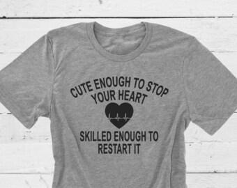 Cute Enough To Stop Your Heart Skilled Enough To Restart It. Nurse Shirt. Nurse Life. Top Knot Nurse. Nurses Rock. Nurse Practitioner. Nurse