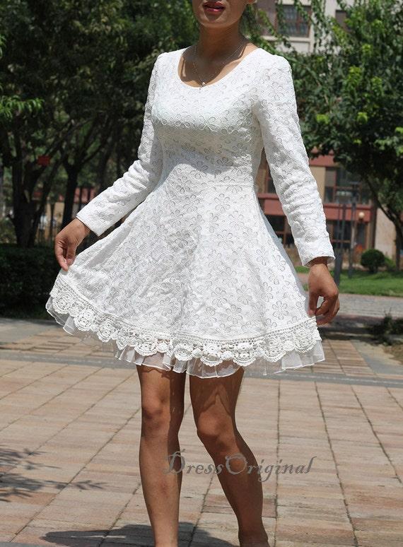 Vestidos blancos cortos con manga larga