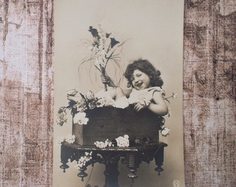 vintage postcard with a happy girl with flowers