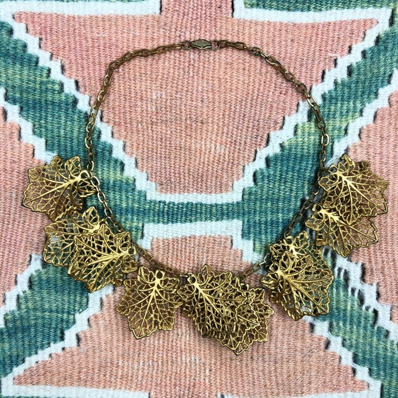 1940's gold celluloid dangle leaf necklace