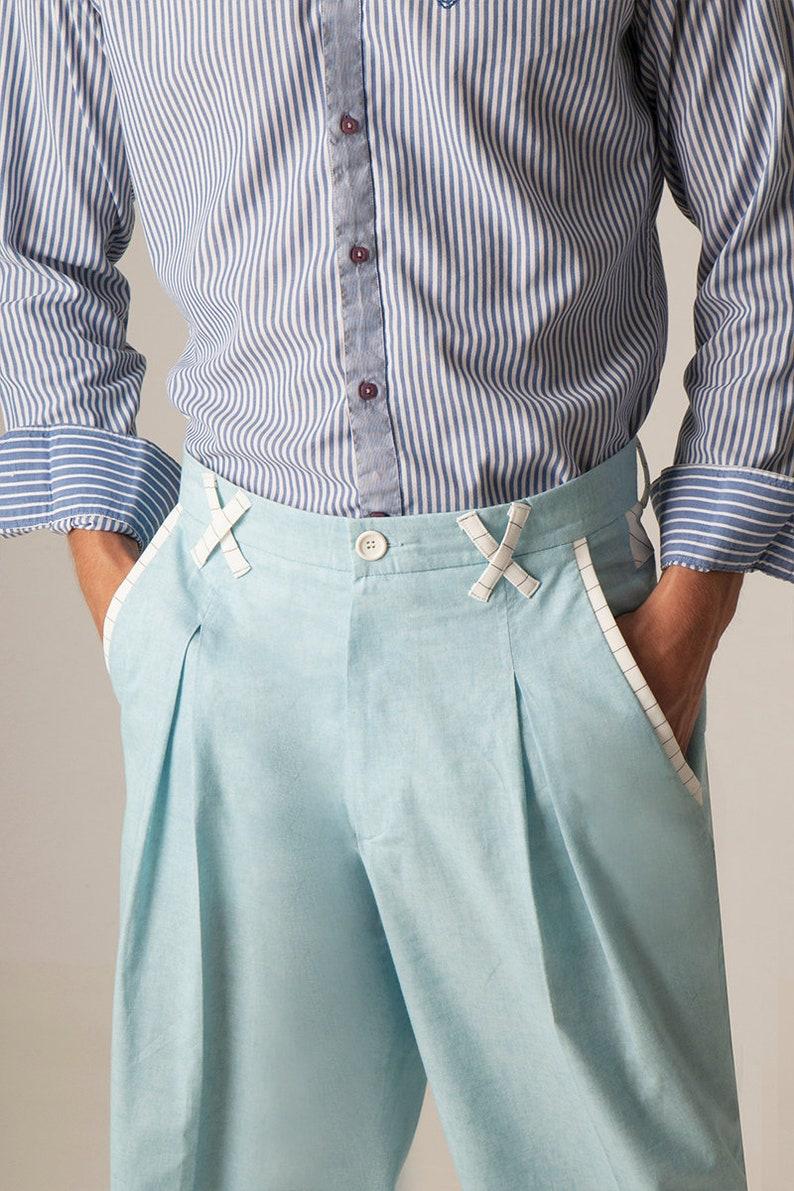 1950s Men's Pants, Trousers, Shorts | Rockabilly Jeans, Greaser Styles Men Argentine Tango pants Mens cotton light blue pants Men striped detail pants Men latin dance pants Mens summer evening pants $195.07 AT vintagedancer.com