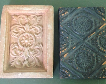Set of 2 terracotta antique tiles.
