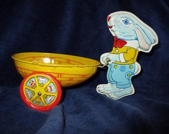 J. Chein Tin Lithograph Blue Bunny Pushing Egg Cart