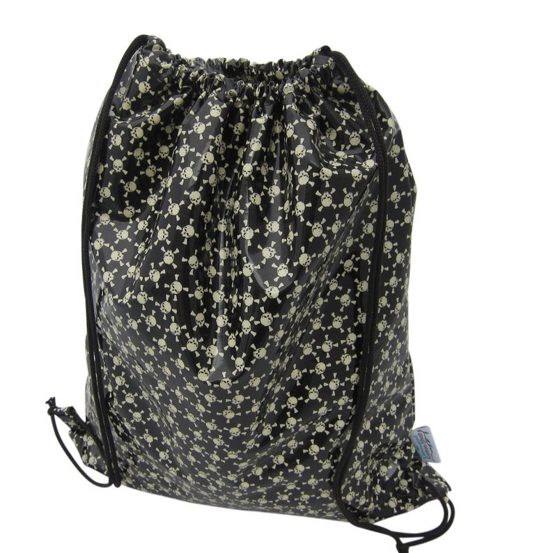 waterproof backpack bag glow in the dark skulls image 0