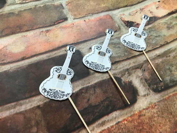 White Guitar Cupcake Sticks Inspired By Disney S Coco Guitar Fiesta Party Guitar Decorations Cinco De Mayo Party