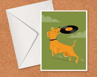 Dog playing frisbee with vinyl record