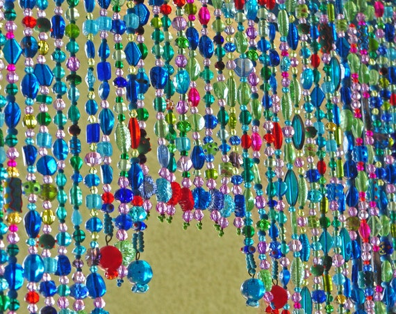 Arch-Shaped Glass-Beaded Valance in Shadows of turquoise blue green purple red and fuchsia