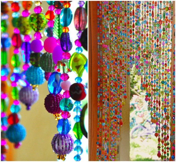 Beaded curtain, Arched shape in shadows of purple, pink, blue and touches of green Turquoise and gold