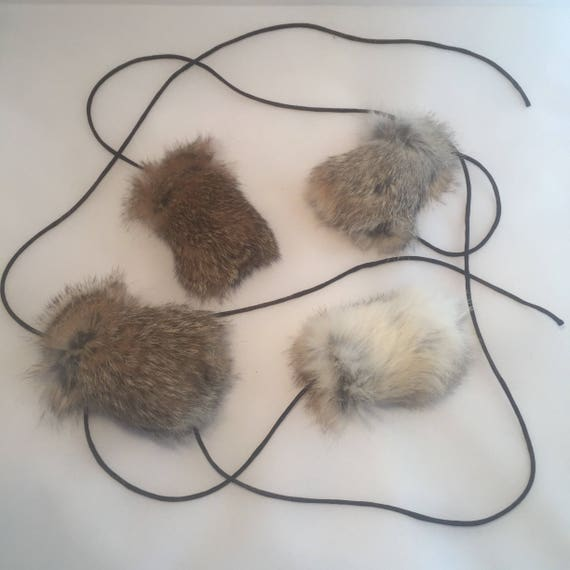 Rabbit Fur chirp toy on a long string