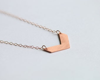 Smooth chevron copper necklace on 14k rose gold filled chain // rose gold geometric charm // minimalist layered jewelry // everyday style