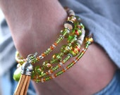 Multi-Strand Beaded Memory Wire Bracelet-Green and Orange Hanging Tassel