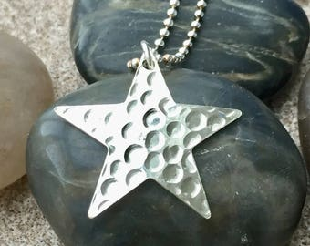 Solid silver large dotty star pendant with silver chain.