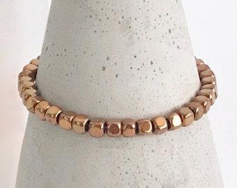 QUINSCO - Small Bronze/Copper Hematite Bead Stretch Bracelet