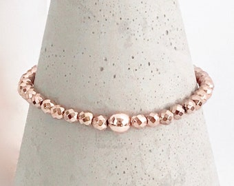 QUINSCO - Small Rose Gold Hematite Bead Stretch Bracelet with Rose Gold Hardware