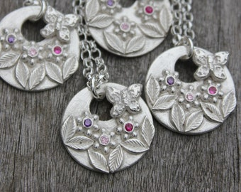 Flower garden pendant with butterfly and gemstone flowers