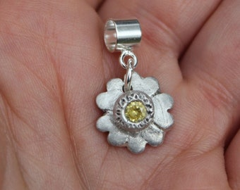Primrose Pandora charm, featuring this colourful Spring flower, handmade in solid silver with yellow topaz