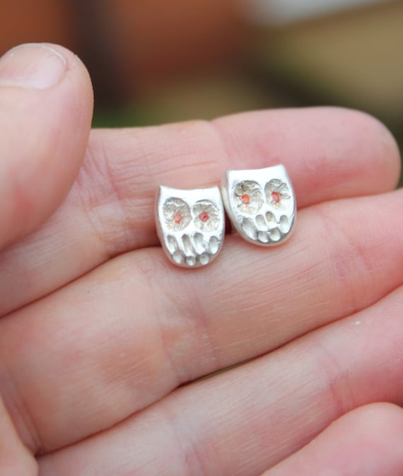 Owl stud earrings handmade in fine silver with gemstone owl eyes. These tiny owls make the perfect owl lover gift.