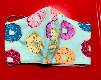 Face Mask Made From Blue Large Tossed Donuts Fabric
